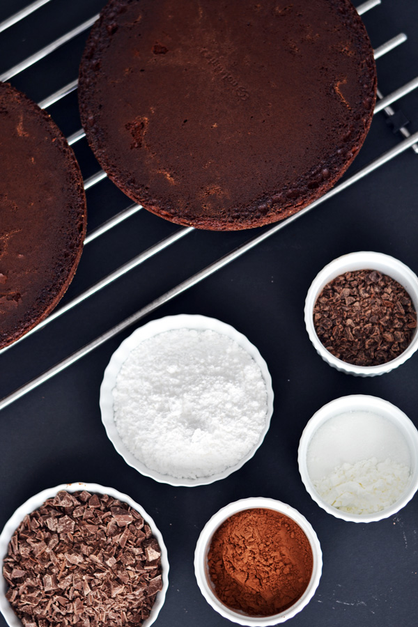 Baked cakes and chocolate ingredients for Triple Chocolate Cake