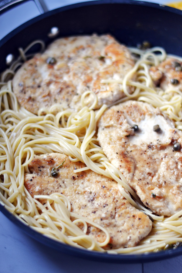 Nestled Lemon Chicken Piccata in linguine noodles.