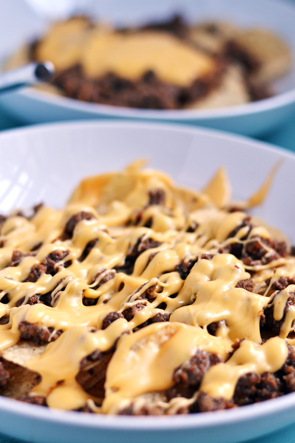 Close up shot of cheese covered nachos.