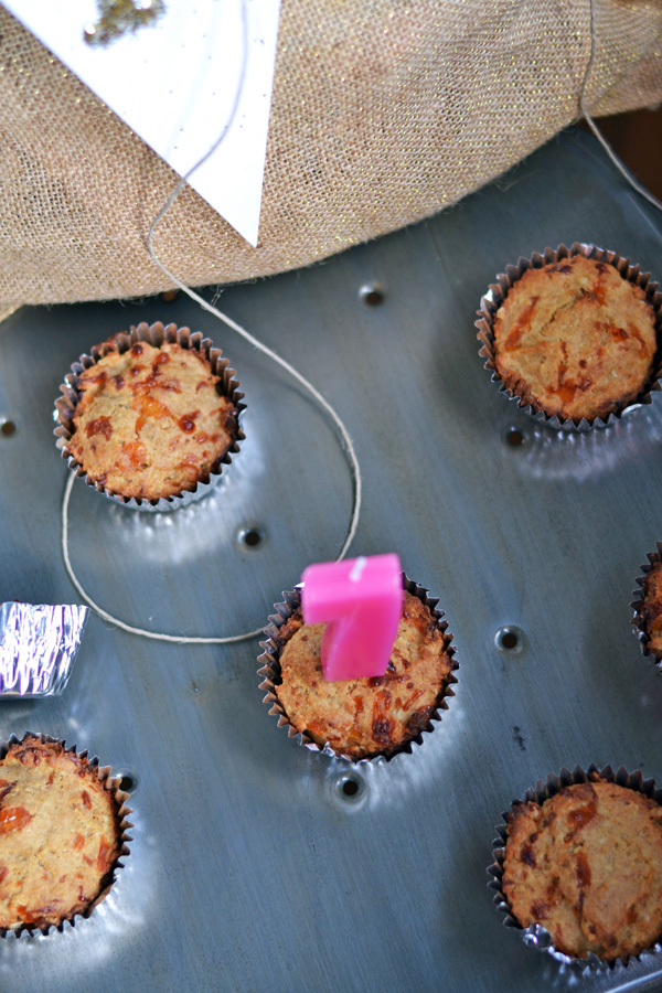 Dog Pupcakes with 1 birthday candle.