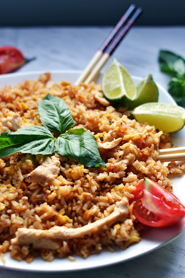 Side view of Thai Chicken Fried Rice garnished with basil leaves