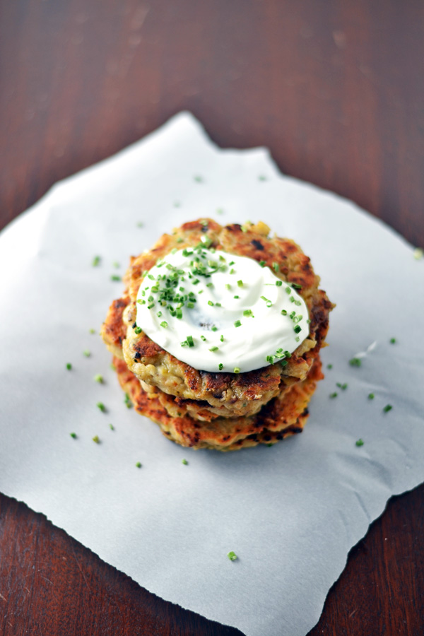 Plated Mashed Potato Bacon Pancakes with sour cream and chives.