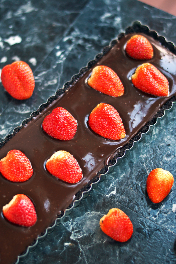 Plump juicy strawberries placed in No Bake Strawberry Chocolate Tart