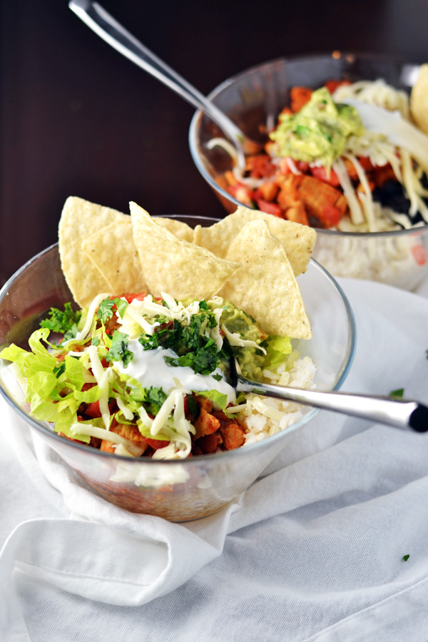 Chicken Burrito Bowls with tortilla chips for serving.